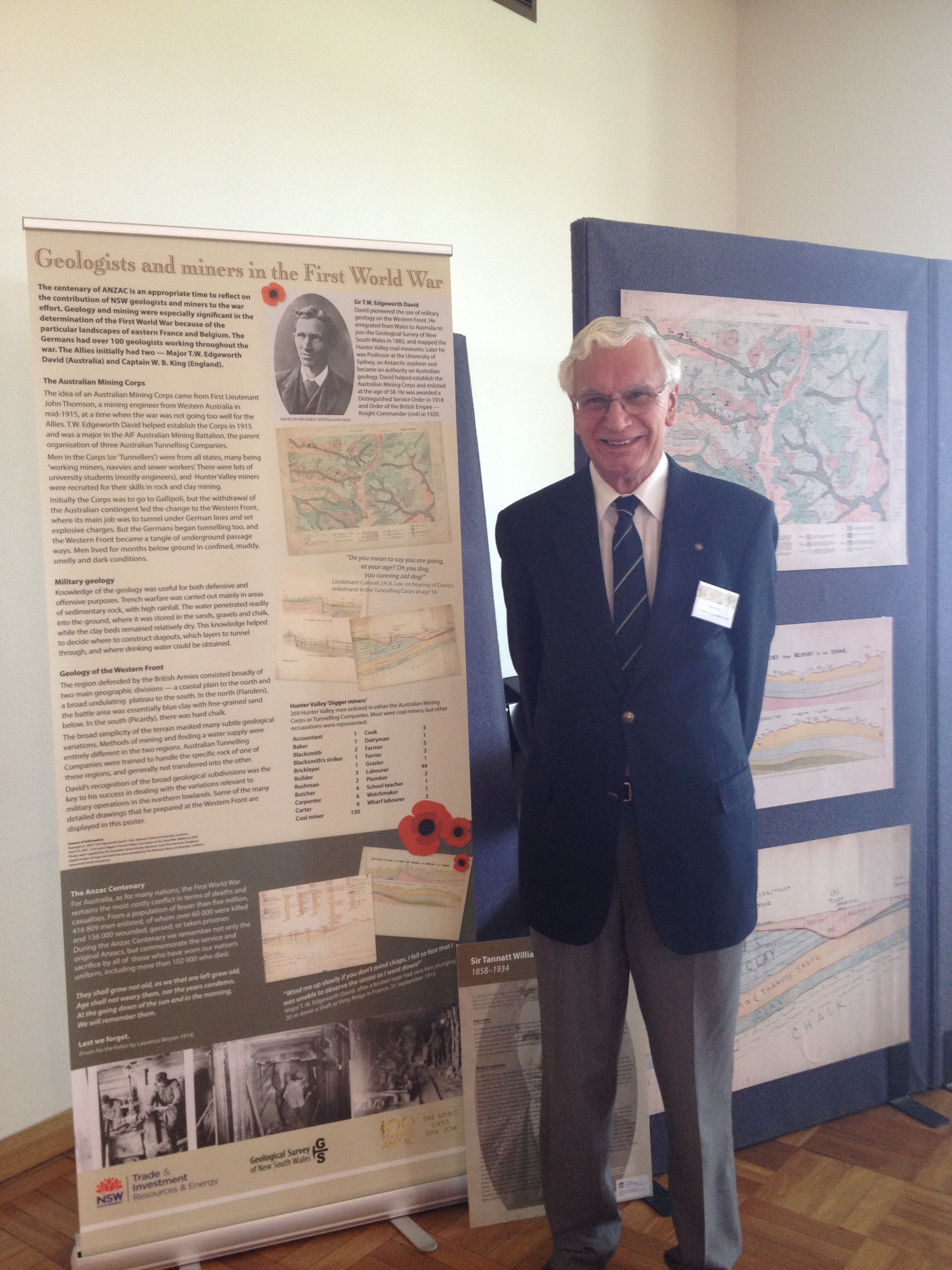 Dr Stuart Braga standing in front of the Geologist and Miners of the First World War display that included maps drawn by Edgeworth David