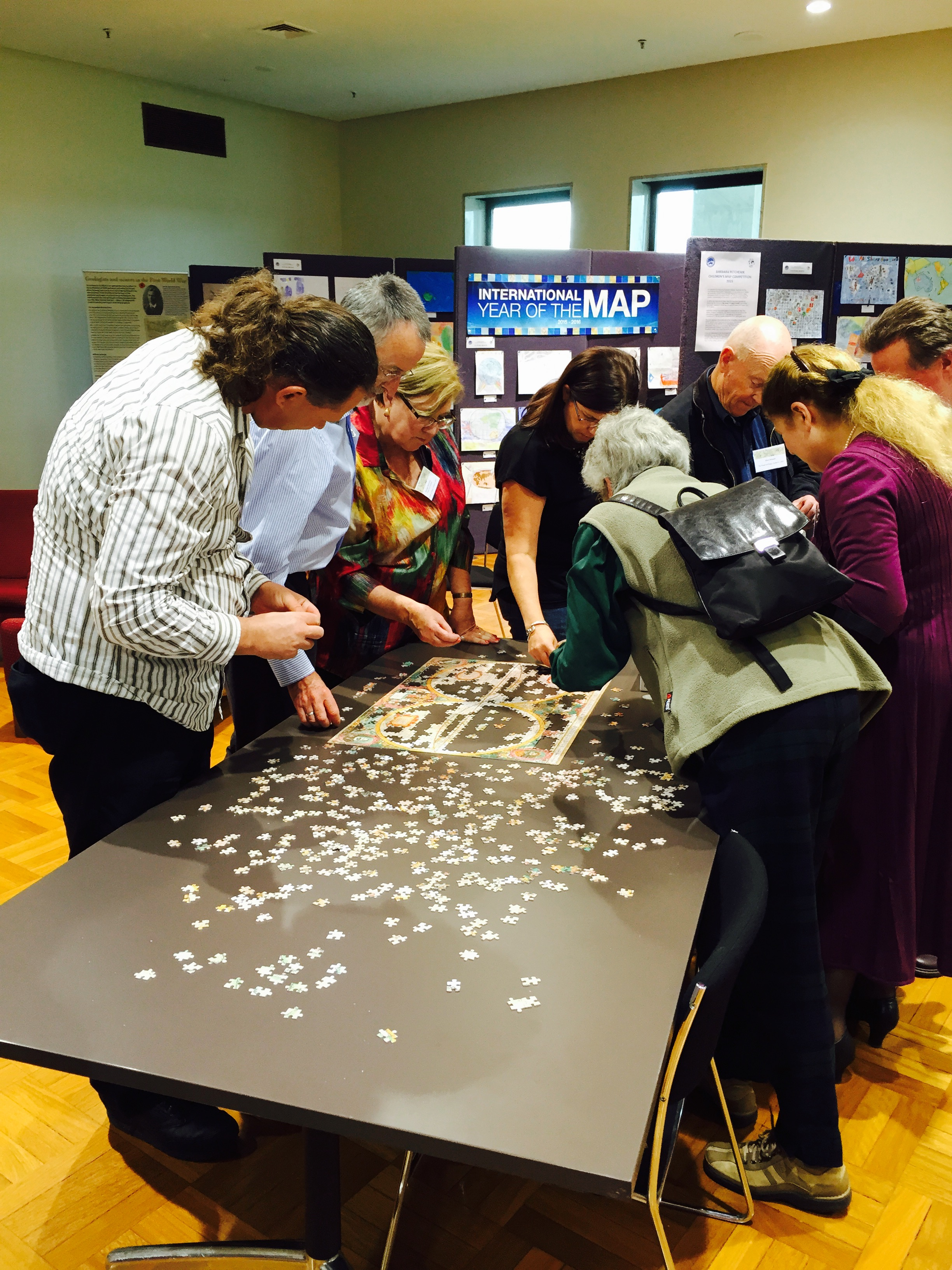 Attendees enjoying the challenge of a good jigsaw puzzle