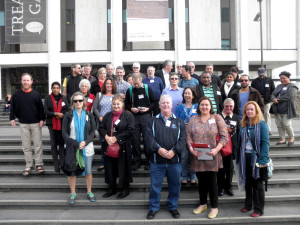 Attendees gather on steps of NLA ready to depart for the tour
